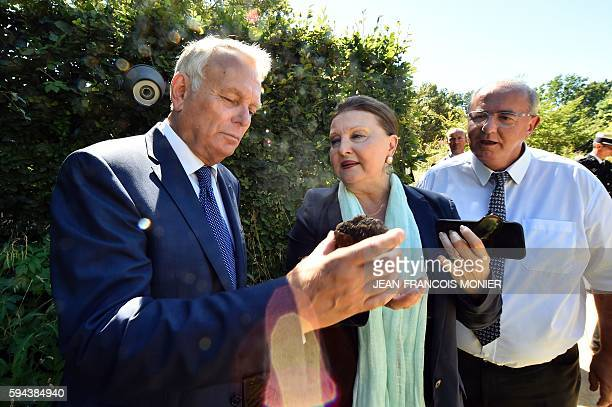 French Foreign Affairs Minister JeanMarc Ayrault the chateau director Chantal ColleuDumond and Maurice Leroy president of the Departmental Council of...