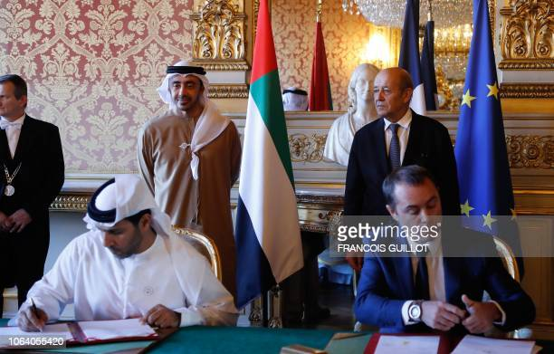 French Foreign Affairs Minister JeanYves Le Drian and Foreign Affairs Ministers of the United Arab Emirates Abdullah bin Zayed AlNahyan follow the...
