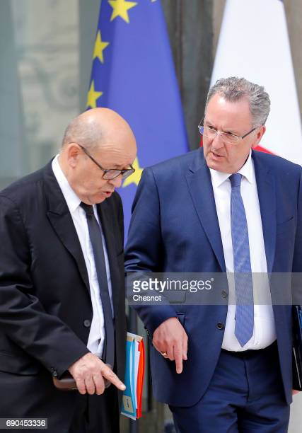 French Foreign Affairs minister JeanYves Le Drian and Richard Ferrand leave the Elysee Presidential Palace after a weekly cabinet meeting on May 31...