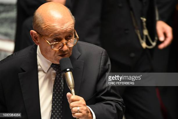 French Foreign Affairs Minister JeanYves Le Drian delivers a speech during an extraordinary session at the French National Assembly held for the...