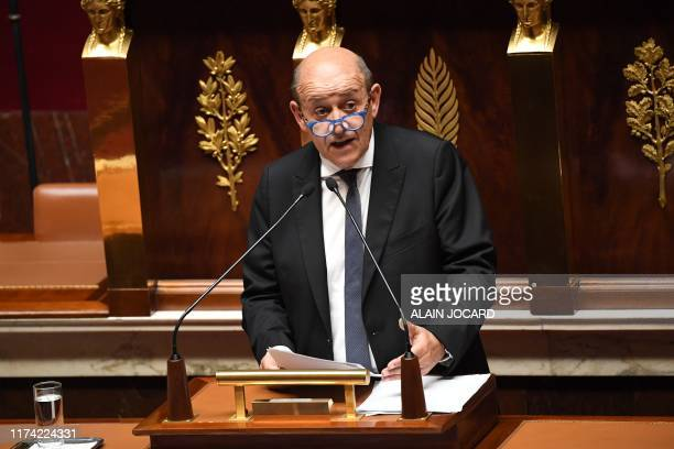 French Foreign Affairs Minister JeanYves Le Drian delivers a speech during a debate about the immigration policy of France at the National Assembly...