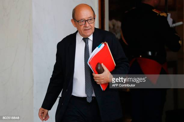 French Foreign Affairs Minister JeanYves Le Drian leaves the Elysee Palace in Paris after the weekly cabinet meeting on June 28 2017 / AFP PHOTO /...