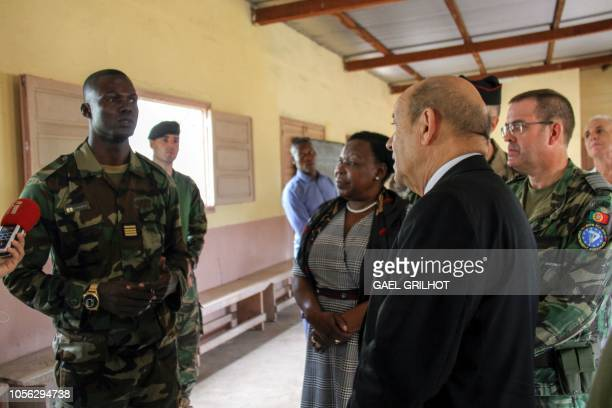 French Foreign Affairs Minister JeanYves Le Drian speaks to the commanding officer of the amphibious battalion Commandant Bongo Wakoro Flavien as he...