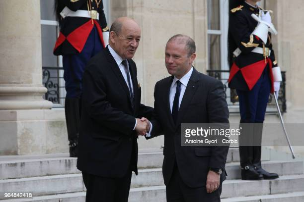 French Foreign Affairs Minister JeanYves Le Drian welcomes Malta Prime Minister Joseph Muscat upon his arrival for the international congress on...