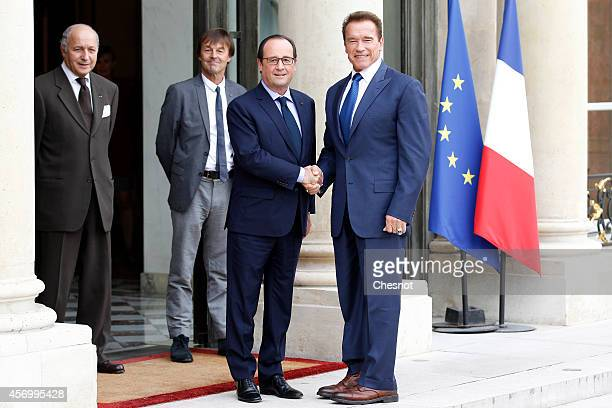 French Foreign Affairs minister Laurent Fabius and environmental activist and presidential advisor Nicolas Hulot stand as French president Francois...