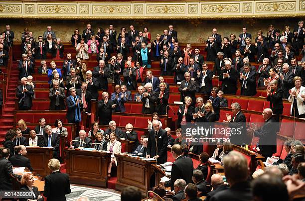 French Foreign Affairs minister Laurent Fabius is applauded after delivering a speech during a session of questions to the government on December 15...