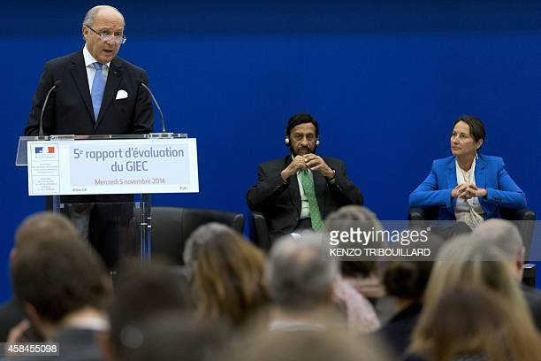 French Foreign Affairs minister Laurent Fabius speaks next to the head of the UN's climate science panel Rajendra Pachauri and French minister for...
