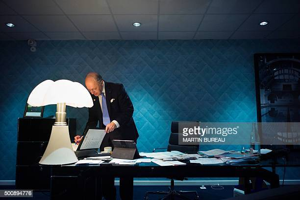 French Foreign Affairs minister Laurent Fabius works in his office during the COP 21 United Nations Conference on climate change on December 10 2015...