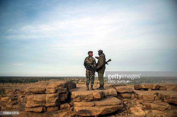 A French foreign legion paratrooper stands beside a Malian soldier near Sevare on January 23 2013 African forces on Wednesday began moving towards...