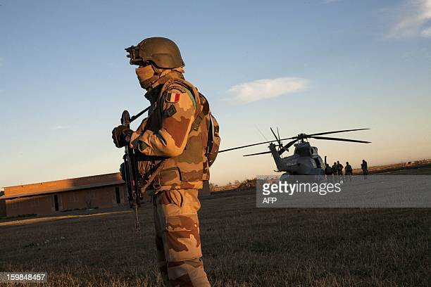 A French Foreign Legion soldier stands guard as groups from various units of the Air Force Ground Army and the French Foreign Legion prepare to fly...