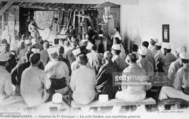 French Foreign Legion soldiers relax during rest time by watching a theatre production at a caserne or military barracks in a garrison town Algeria...
