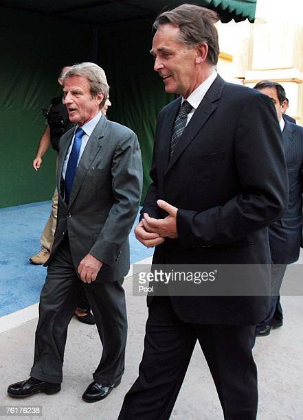 French Foreign Minister Bernard Kouchner and German deputy special representative of the UN SecretaryGeneral Michael von der Schulenburg arrive at a...