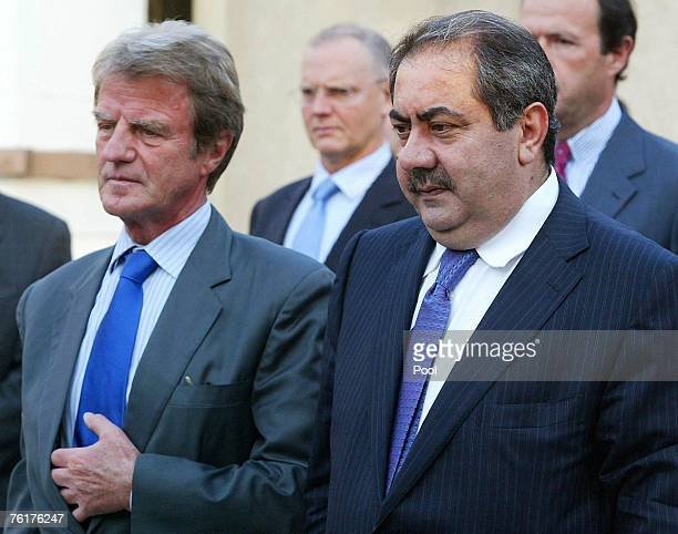French Foreign Minister Bernard Kouchner and his Iraqi counterpart Hoshyar Zebari attend a memorial outside the UN headquarters in the Green Zone on...