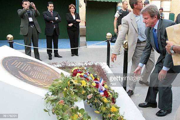 French Foreign Minister Bernard Kouchner lays a wreath at a memorial monument outside the UN headquarters in the Green Zone on August 19 2007 in...