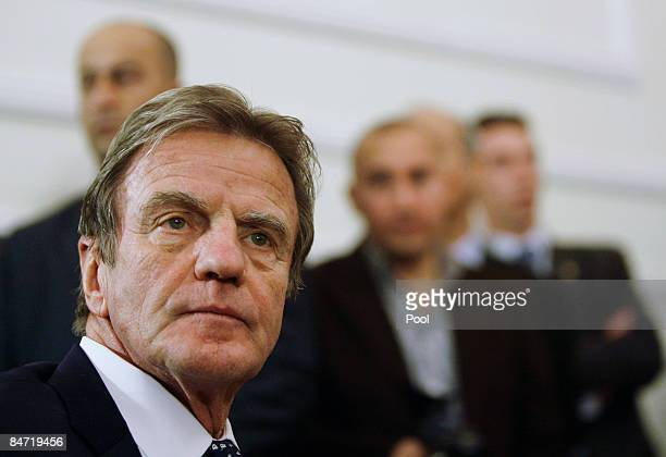 French Foreign Minister Bernard Kouchner looks on during a joint press conference with French President Nicolas Sarkozy and Iraqi President Jalal...