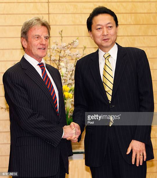 French foreign minister Bernard Kouchner shakes hands with Japanese Prime Minister Yukio Hatoyama prior to their talks at Hatoyama's official...