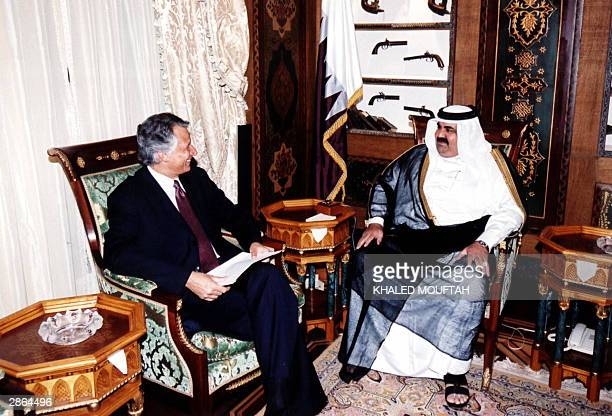 French Foreign Minister Dominique de Villepin meets with Qatari Emir Sheikh Hamad bin Khalifa alThani in Doha 13 January 2004 De Villepin who is on a...