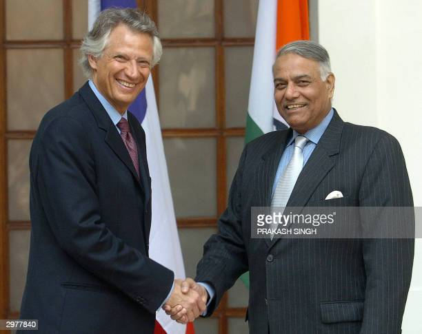French Foreign Minister Dominique de Villepin shakes hands with his Indian counterpart Yashwant Sinha prior to a meeting in New Delhi 13 February...