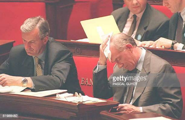 French Foreign Minister HervT de Charette wipes his forehead 20 June after speaking at the French national assembly De Charette staunchly defended...