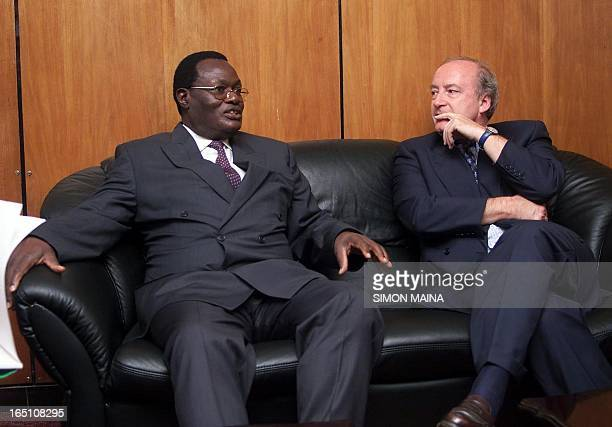 French Foreign Minister Hubert Vedrine meets with his Kenyan counterpart Chris Obure upon his arrival at the Jomo Kenyatta International Airport in...