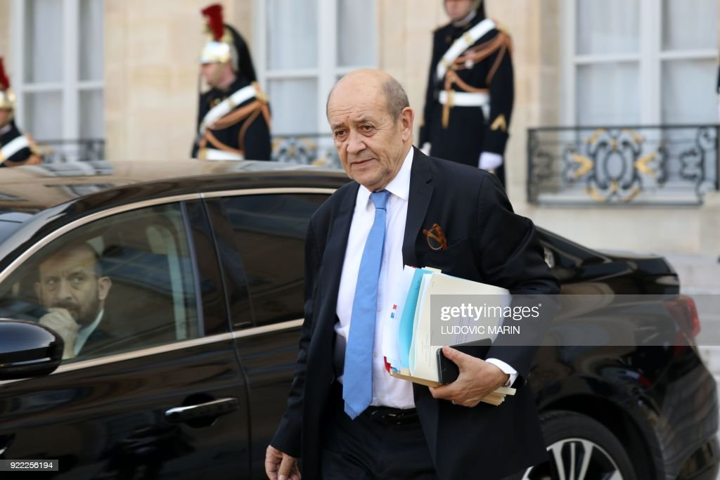 French Foreign Minister Jean Yves Le Drian leaves The Elysee Palace in Paris on February 21, 2018, after attending a lunch function given for Liberian President George Weah. /