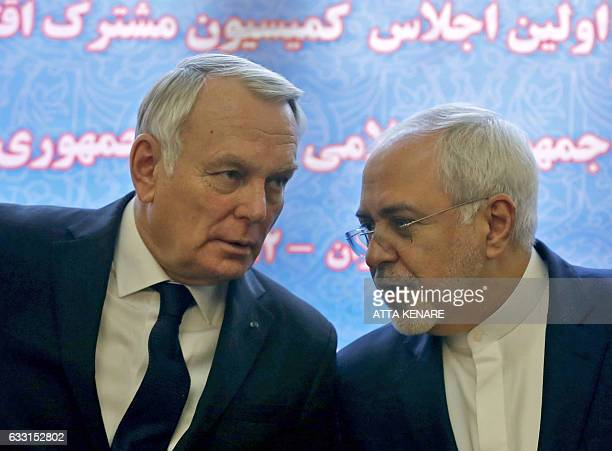 French Foreign Minister JeanMarc Ayrault and Iranian Foreign Minister Mohammad Javad Zarif smile after signing economic agreements in Tehran on...