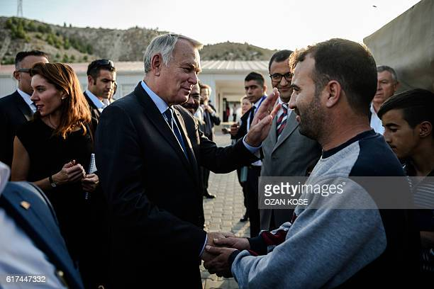 French Foreign Minister JeanMarc Ayrault meets with Syrian refugees during a visit to a refugee camp in the Kilis district of Gaziantep southeastern...