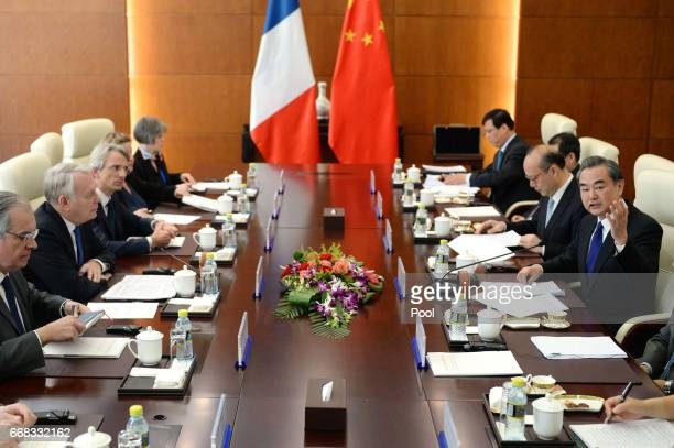 French Foreign Minister Jean-Marc Ayrault, second from left, meets with Chinese Foreign Minister Wang Yi, right, on April 14, 2017 at the Ministry of...