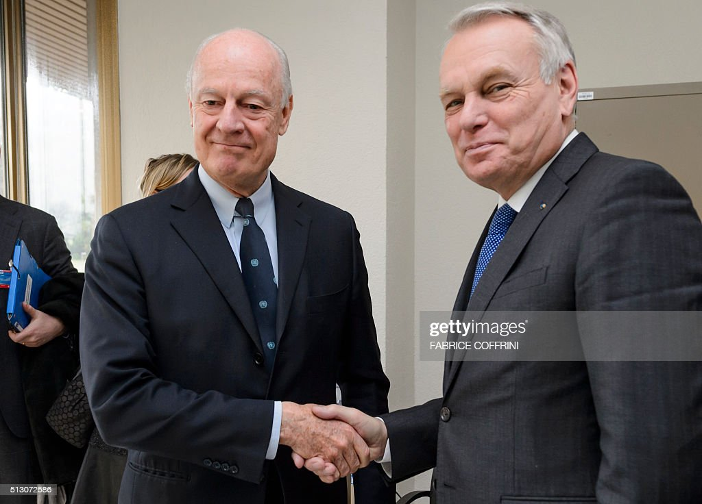 French Foreign Minister Jean-Marc Ayrault (R) shakes hands with UN Special Envoy for Syria Staffan de Mistura during a meeting on the sidelines of the main annual session of the United Nations Human Rights Council in Geneva on February 29, 2016. Ayrault called for a new meeting of a UN-backed task force overseeing a fragile Syria ceasefire 'without delay' to evaluate a range of breaches. / AFP / FABRICE