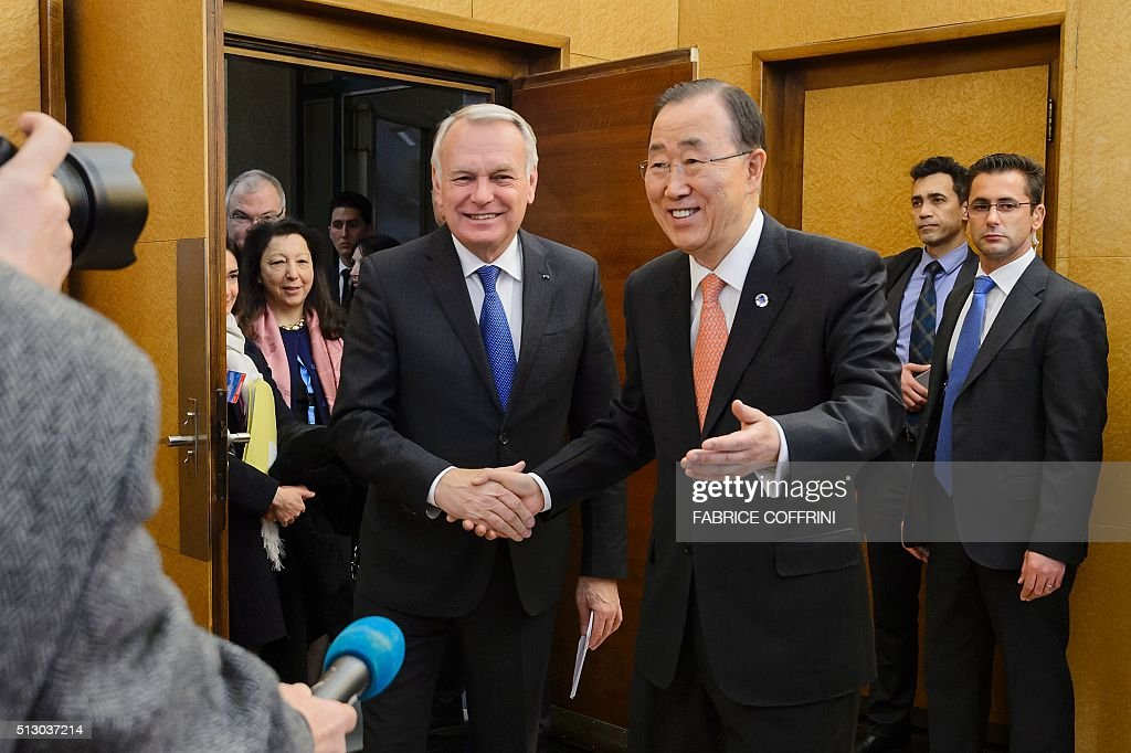 French Foreign Minister Jean-Marc Ayrault (L) shakes hands with United Nations Secretary General Ban Ki-moon during a meeting on the sidelines of the main annual session of the United Nations Human Rights Council in Geneva on February 29, 2016. French Foreign Minister Jean-Marc Ayrault called for a new meeting of a UN-backed task force overseeing a fragile Syria ceasefire 'without delay' to evaluate a range of breaches. / AFP / FABRICE