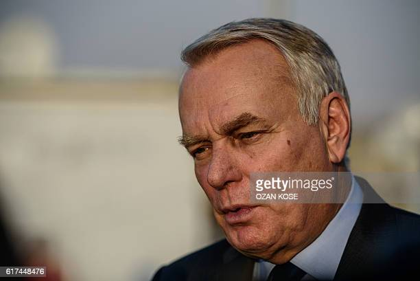 French Foreign Minister JeanMarc Ayrault speaks to the press during a visit to a refugee camp in the Kilis district of Gaziantep southeastern Turkey...