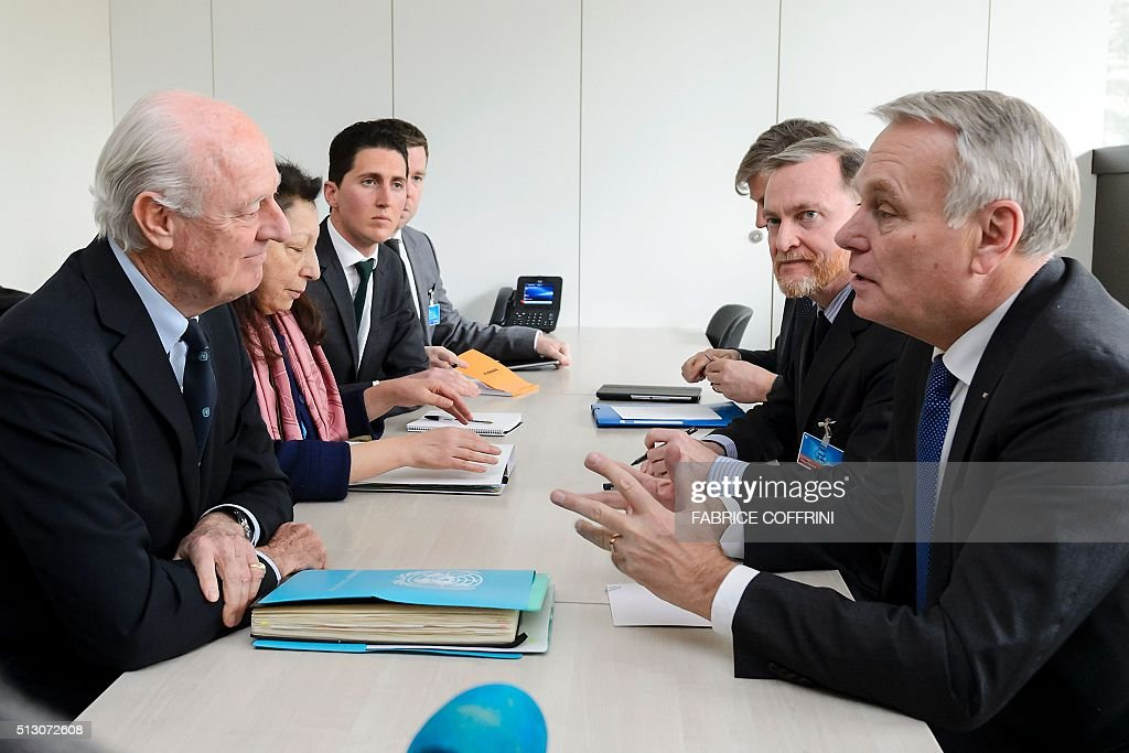 French Foreign Minister Jean-Marc Ayrault (R) speaks with UN Special Envoy for Syria Staffan de Mistura (L) during a meeting on the sidelines of the main annual session of the United Nations Human Rights Council in Geneva on February 29, 2016. Ayrault called for a new meeting of a UN-backed task force overseeing a fragile Syria ceasefire 'without delay' to evaluate a range of breaches. / AFP / FABRICE