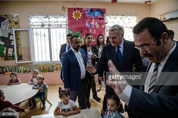 French Foreign Minister JeanMarc Ayrault visits a refugee camp in the Kilis district of Gaziantep southeastern Turkey on October 23 2016 France's...