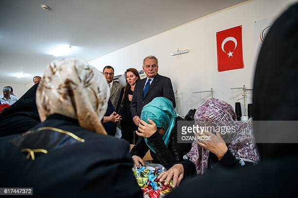 TOPSHOT French Foreign Minister JeanMarc Ayrault visits a refugee camp in the Kilis district of Gaziantep southeastern Turkey on October 23 2016...