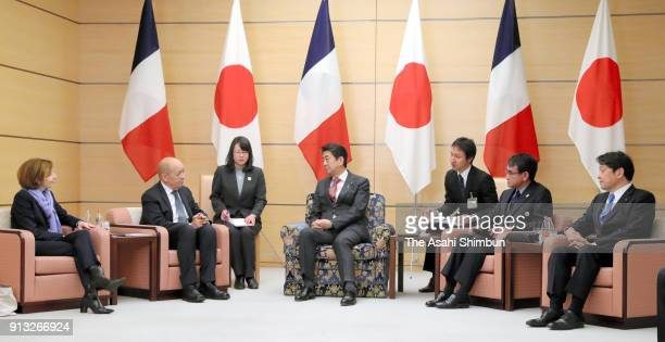 French Foreign Minister JeanYves Le Drian and Defense Minister Florence Parly talk with Japanese Prime Minister Shinzo Abe Foreign Minister Taro Kono...
