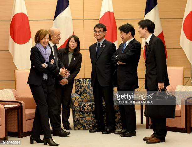 French Foreign Minister JeanYves Le Drian and French Defence Minister Florence Parly chat with Japanese Foreign Minister Taro Kono and Japanese...