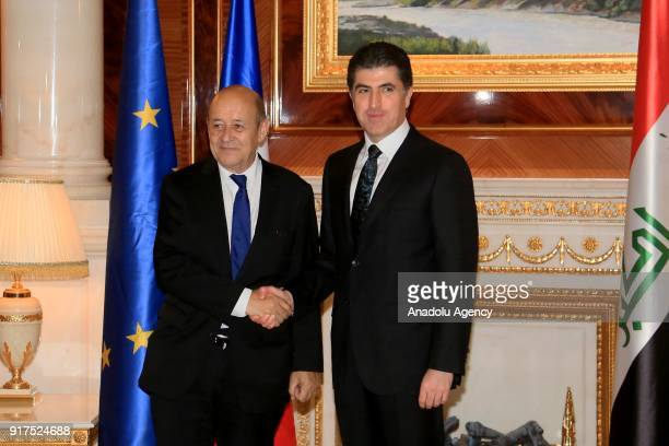 French Foreign Minister JeanYves Le Drian and Iraqi Kurdish Regional Government Prime Minister Nechirvan Barzani shake hands during their meeting in...