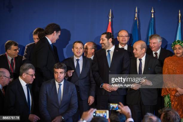 French Foreign Minister JeanYves Le Drian Lebanon's Prime Minister Saad alHariri and UN Deputy Secretary General Amina Mohammed pose for a family...