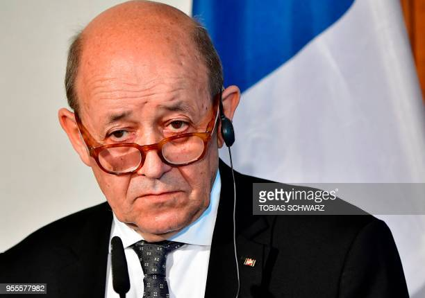French Foreign Minister JeanYves Le Drian looks on during a joint press conference with his German counterpart prior a meeting to discuss the EU...