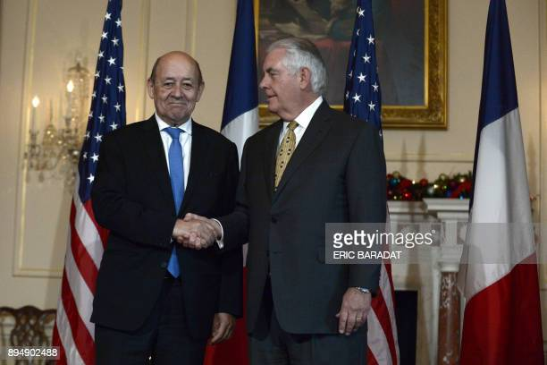 French Foreign Minister JeanYves Le Drian meets his US counterpart Rex Tillerson at the State Department in Washington DC on December 18 2017 / AFP...