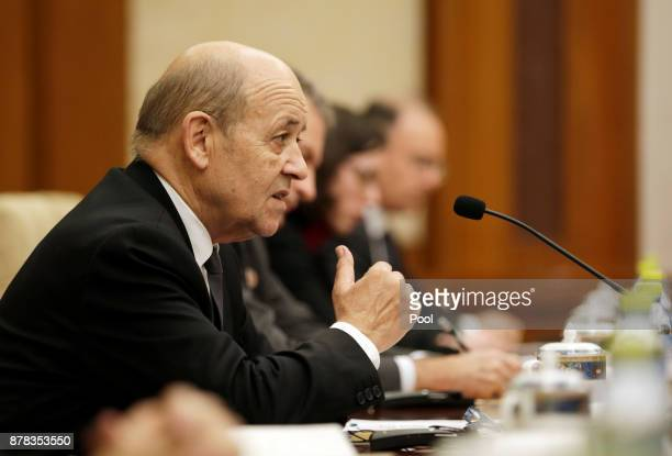 French Foreign Minister JeanYves Le Drian speaks during a meeting with China's Foreign Minister Wang Yi at Diaoyutai State Guesthouse on November 24...