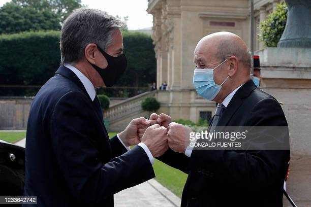French Foreign Minister Jean-Yves Le Drian welcomes US Secretary of State Antony Blinken as he arrives for a meeting at the Quai d'Orsay in Paris, on...