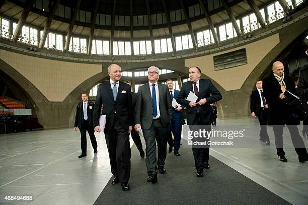 French Foreign Minister Laurent Fabius German Foreign Minister FrankWalter Steinmeier and Foreign Minister of Poland Grzegorz Schetyna meet in...