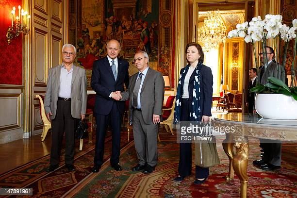 French Foreign Minister Laurent Fabius holds a working meeting with representatives of the Syrian National Council George Sabra Abdel Baset Sayda and...