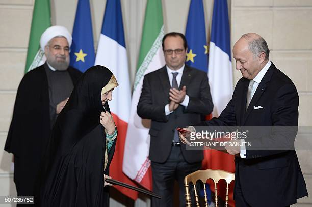 French Foreign Minister Laurent Fabius Iranian Minister of State for Environmental Protection Masoumeh Ebtekar Iranian President Hassan Rouhani and...