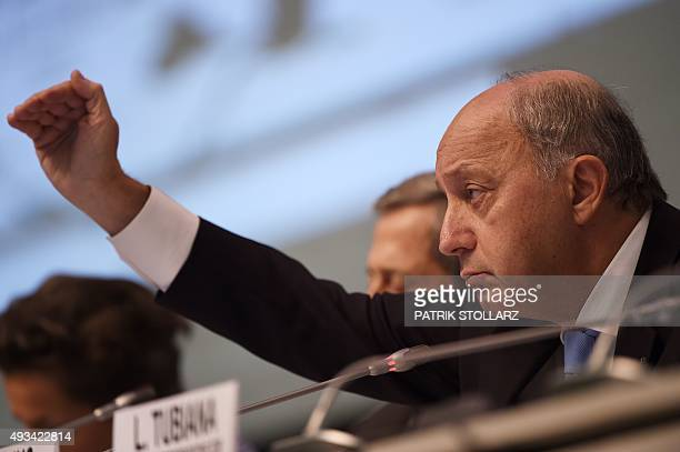 French Foreign Minister Laurent Fabius speaks during the United Nations Framework Convention on Climate Change summit in Bonn western Germany on...