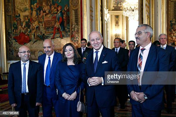 French Foreign Minister Laurent Fabius speaks to the media after his meeting with Tunisian lawyer Fadhel Mahfoudh, Abdessatar Ben Moussa, Head of...