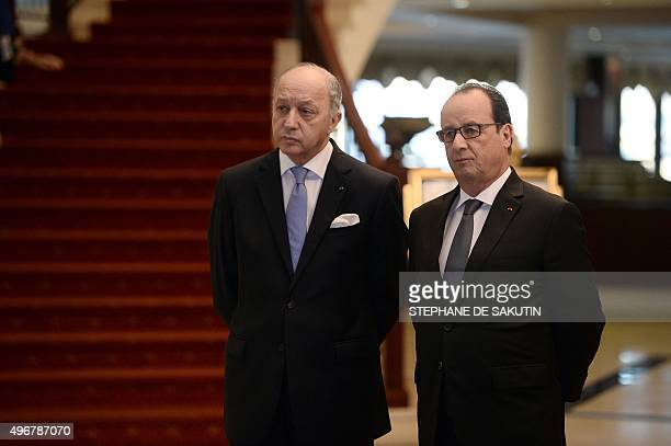 French Foreign Minister Laurent Fabius speaks with French President Francois Hollande prior a pre-COP 21 climate meeting on November 12, 2015 in...