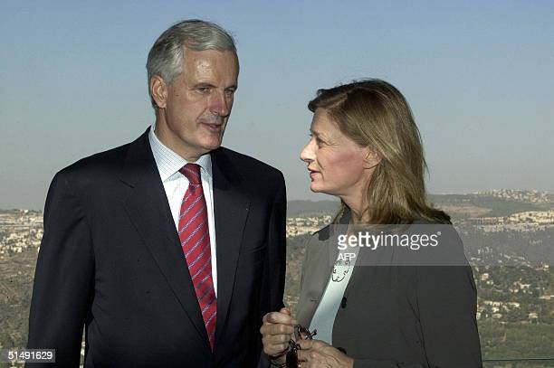 French Foreign Minister Michel Barnier and his wife Isabelle Barnier visit the Yad Vashem Holocaust memorial in Jerusalem 18 October 2004 Barnier is...