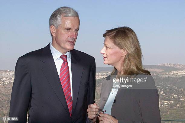 French Foreign Minister Michel Barnier and his wife Isabelle view an upcoming exhibition at a new museum in Yad Vashem October 18 2004 during his...